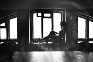 woman sitting by window