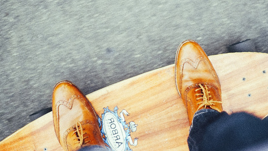 Guy with brown shoes on a skateboard
