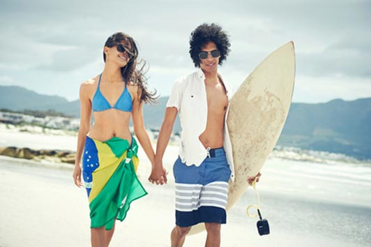 teens at the beach on surfing date