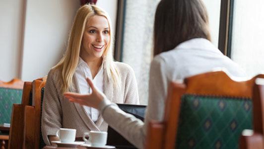 two women in cafe talking