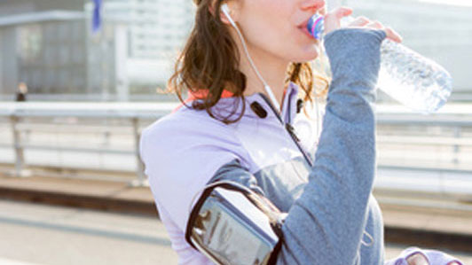 exercise girl drinking from a water bottle