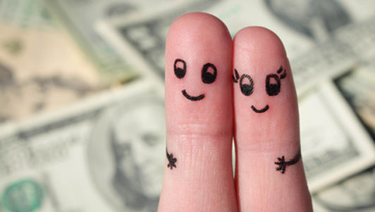 happy finger couple over money