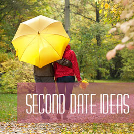 couple walking in park under umbrella