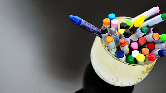 Crayons in a white jar.