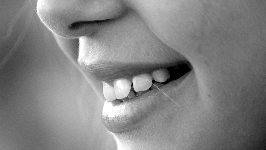Close up of a girl's lips smiling.