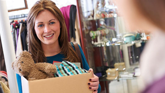 woman holding charity box