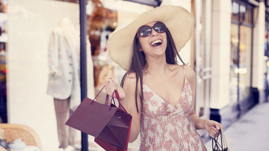 woman in sunglasses enjoying shopping