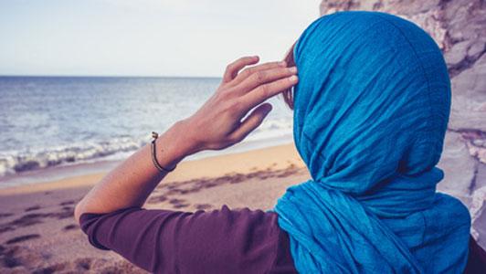 woman in blue head scarf