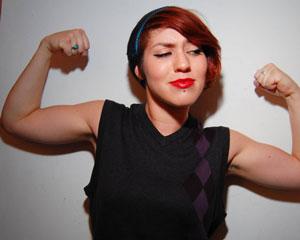 Woman flexing arm muscles