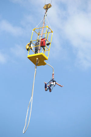 woman as seen bungjee jumping from a crane