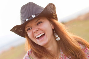 Woman with a nice laugh in a cowboy hat