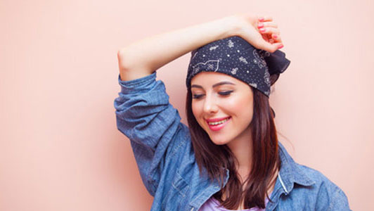happy woman wearing bandana