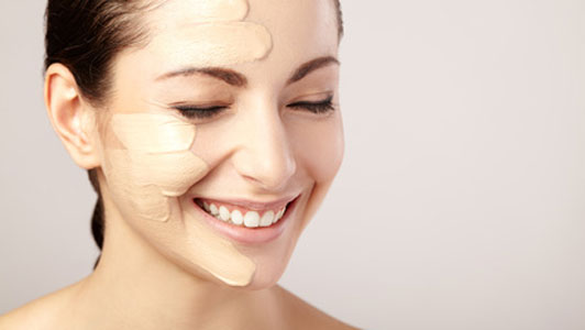 woman with foundation on skin smiling