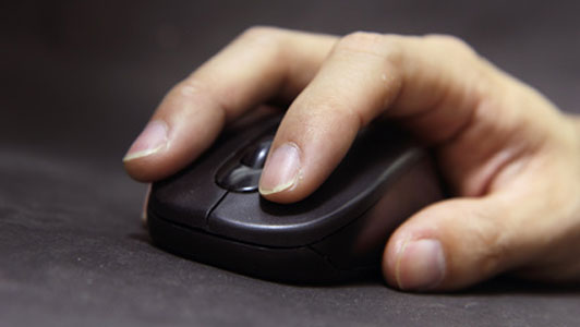 man clicking mouse