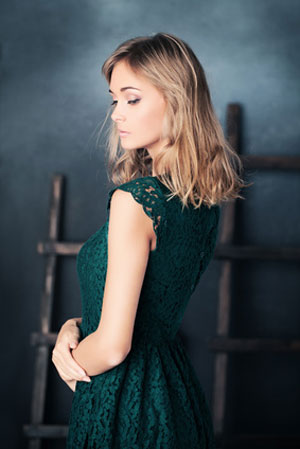 woman in green dress with slight glance back