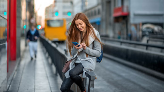 woman with phone in city