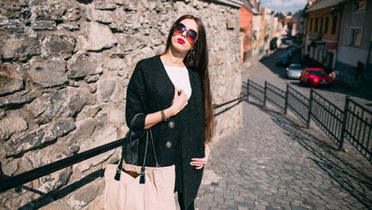 girl holding bag on street