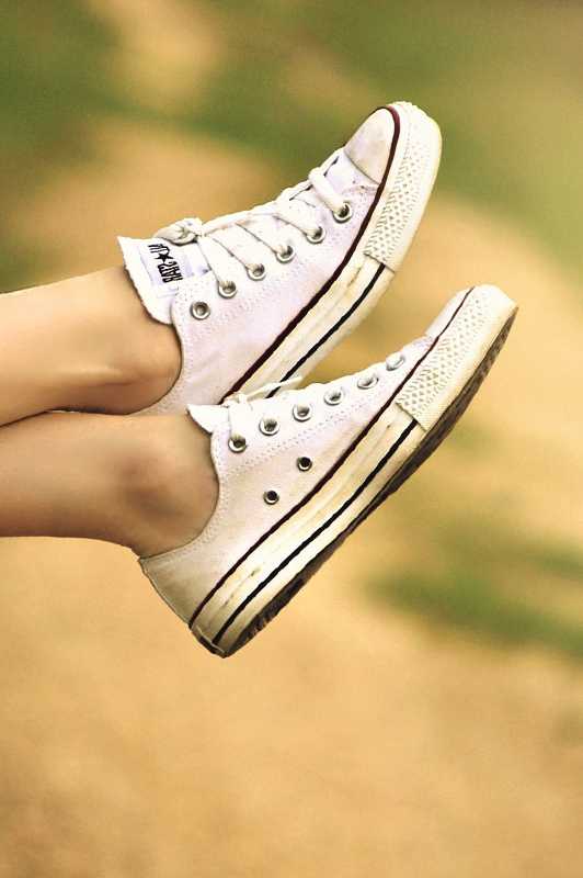 White converse sneakers on a girl's feet
