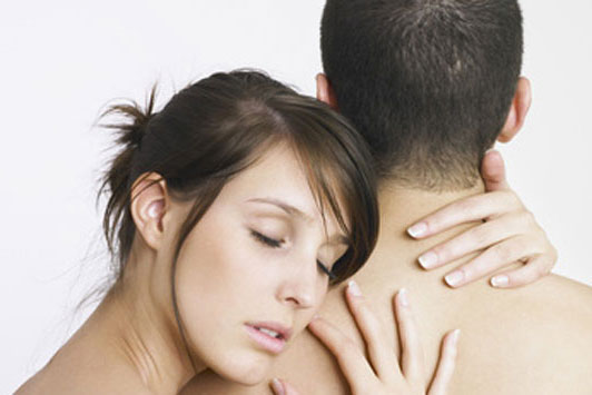 woman hugging guy with hand around back of neck