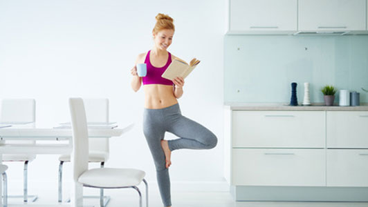 woman reading book during exercise