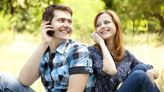 couple talking on phone right next to each other