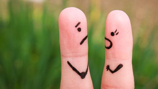 finger couple arguing