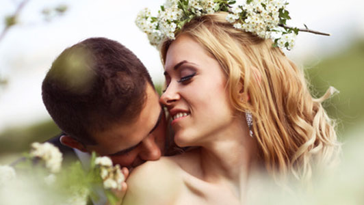 groom kissing shoulder