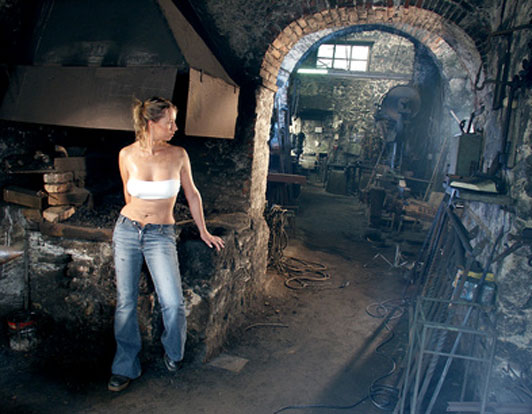 woman blacksmith in workshop
