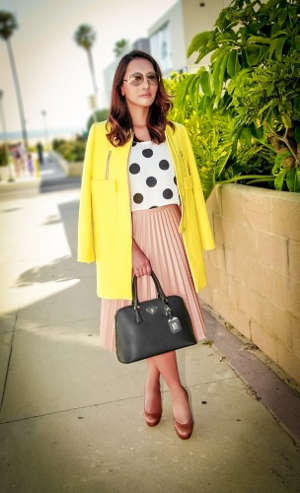 Woman wearing shirt with polka dots and skirt