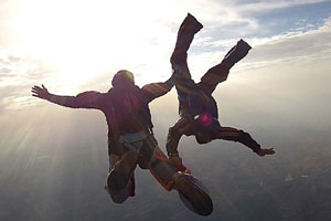 two people in mid skydive