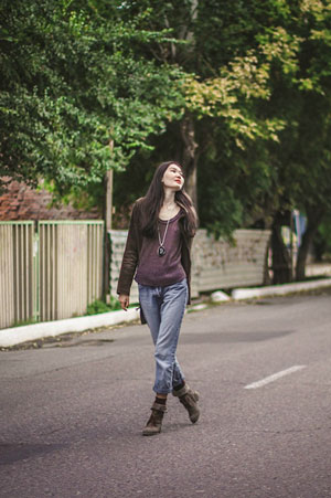 woman in boots walking down street