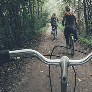 friends biking on trail