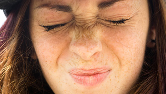 young woman with eyes closed shut