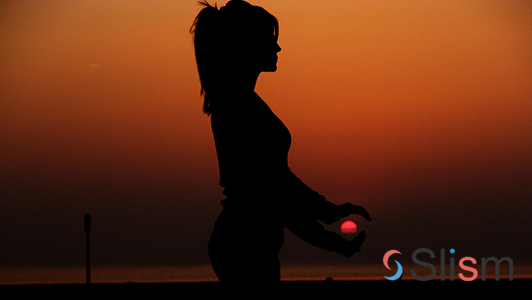 girl practicing yoga in the sunset