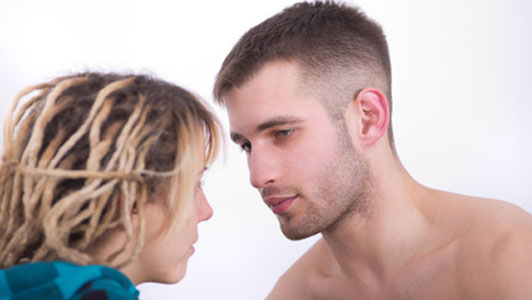man and woman making eye contact