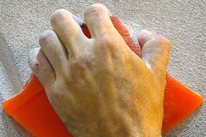 dry skin on hand of man
