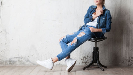women in denim jacket wearing jeans and white tennis shoes