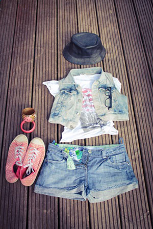 cropped denim urban outfit laid out on wood floor