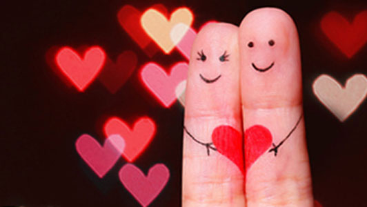 fingers embracing heart