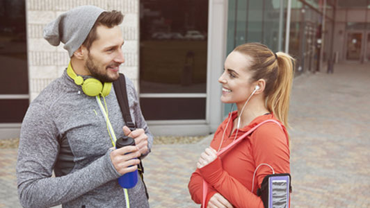 man and woman chat after gym