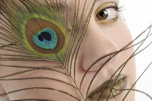 women looking through peacock eye