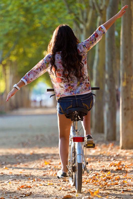 woman riding bike no handle bars
