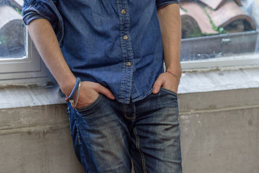 denim guy with hands in pocket