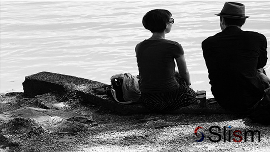 retro couple sitting on a beach