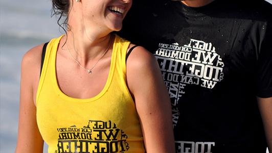 Girl in yellow tank top and a guy in black tee shirt on which says 'together'