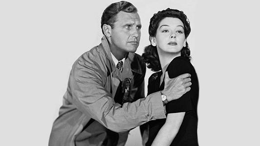 Black and gray photo of movie stars couple.