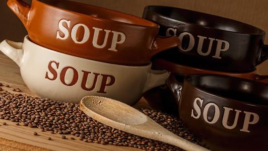 Four brown soup bowls.