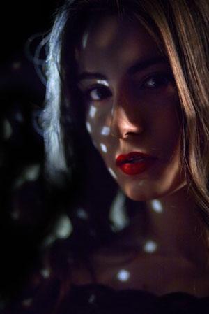 light on woman in dark