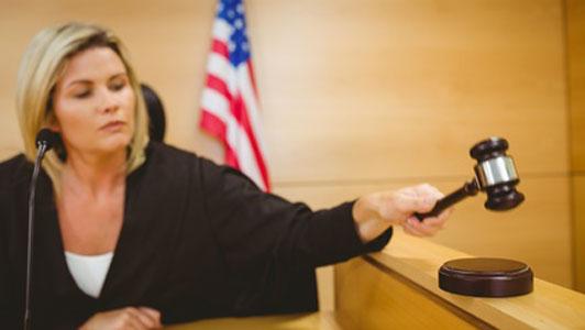 female judge placing judgement with gavel