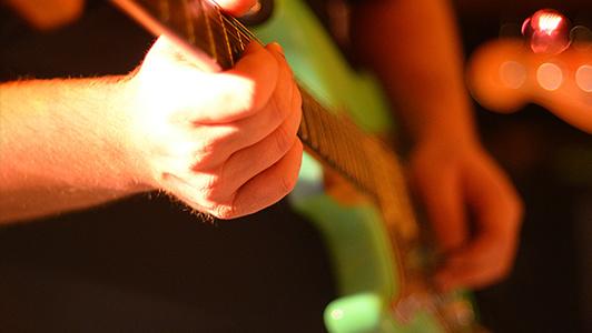 Guy playing an electric guitar.